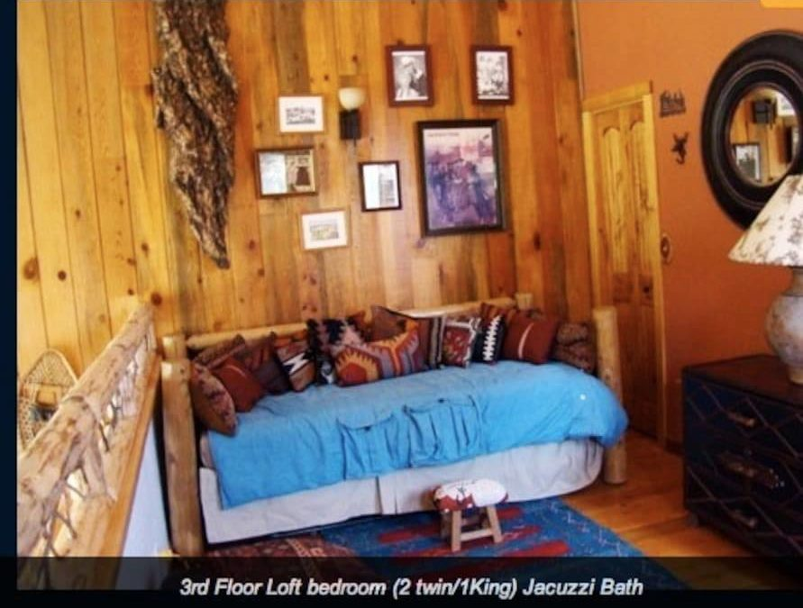 Cozy loft bed converts to either 2 Twins or 1 King. Overlooks living room and expansive windows with mountain view. Western decor with a wink to Roy Rodgers. Don't forget the full on suite bathroom with jacuzzi!