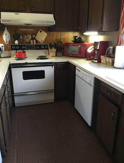 Full kitchen with dishwasher.