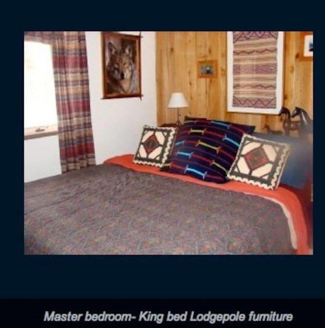 Master bedroom- king size bed, cable television, rear garden view with western animal art theme. Full bath and washer/dryer are right outside your bedroom door. Don't be surprised if a moose walks past the window!